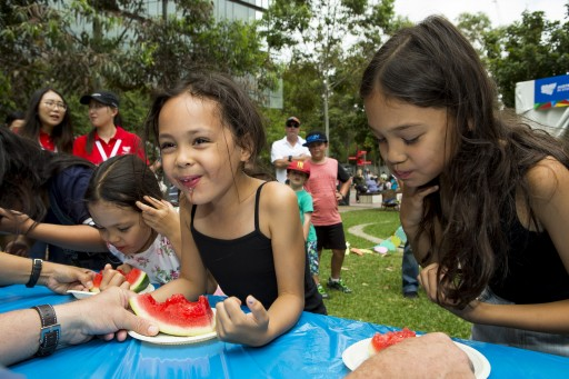 Kids munching down at the watermelon eating contest in Darling Harbour