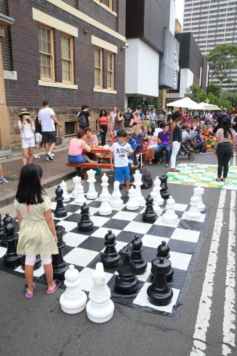 Kids playing giant chess during Australia Day in the Rocks