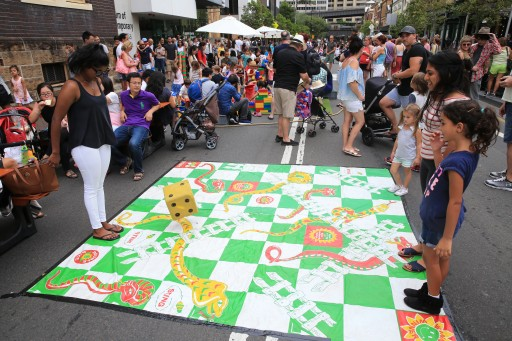 Playing giant snakes and ladders during Australia Day in the Rocks