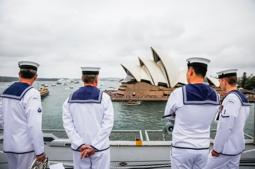 Royal Australian Navy watches the harbour and crowds at the Sydney Opera House from aboard HMAS Canberra