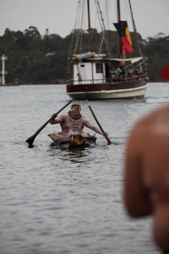 Fire being transported by canoe and the Tribal Warrior from Goat Island to Barrangaro for the Smoking Ceremony